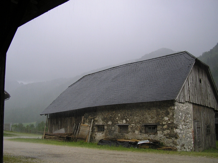 Shelter for the thunderstorm under a farmhouse