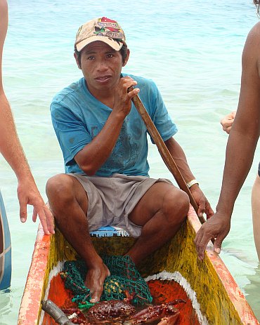 A fisherman pops up at one of the San Blas Islands