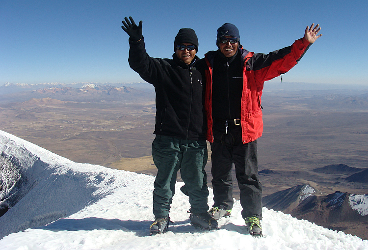 The guide and the teacher on top of the Parinacota volcano