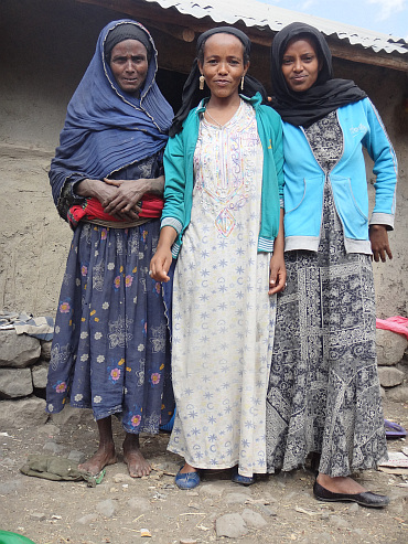 Three women in a settlement halfway the climb