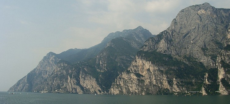 Looking back to the sheer cliffs walls of Lake Garda with the cycling path