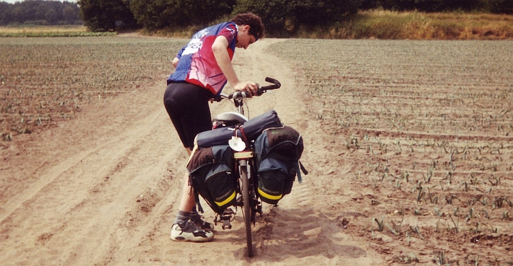 The author is pushing the bike in the Drunense Duinen, Netherlands