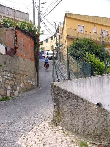 On an ultra steep cobblestone descent in an outskirt of Lisbon