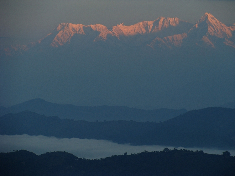 Himalaya Sunrise. From left to right Annapurna South (7.219 m), Baraha Shikhar (7.647 m) and Macchapucchare (6.997 m)